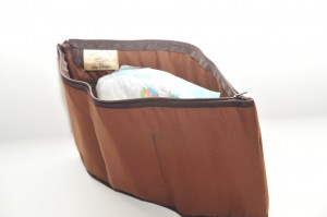 Brown Purse to Go organizer with diaper, check book peeking out of the top