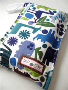 Lou Bugs Boutique On the Go Diaper Pouch Cover in Blue and Green modern zoo animal print