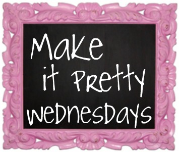 Pink ornate sign that says Make it pretty Wednesdays in white lettering on a black chalkboard like background