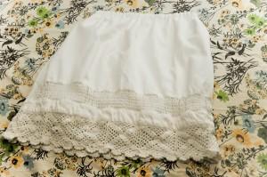 a white crochet pillowcase skirt