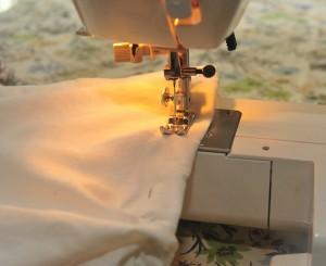 sewing machine sewing seam in pillowcase