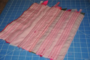 backside of fabric with strips of ribbon sewn on.