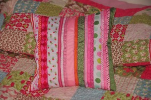 ribbon pillow sitting on top of quilt