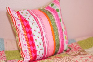 Pillow made of pink and green ribbon