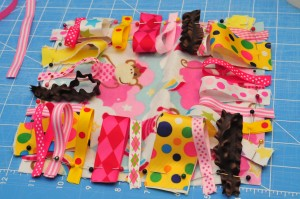 ribbons pinned on a square of fabric.