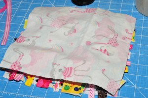 back side of fabric square facing up.