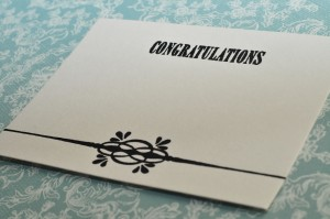 card with congratulations letterpressed along the top.