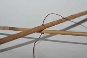 hemp string going through bamboo sticks.