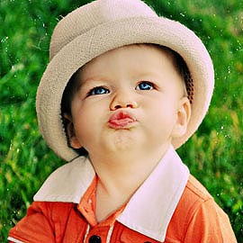 little boy wearing a Fore Trilby Natural Straw Hat
