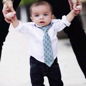 little boy wearing blue tie