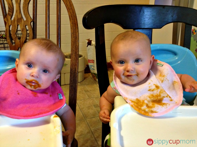 Twins eating solids