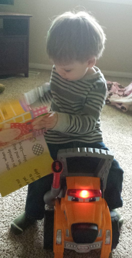 Myles can sit on this toy, and even take along a favorite book for the ride.