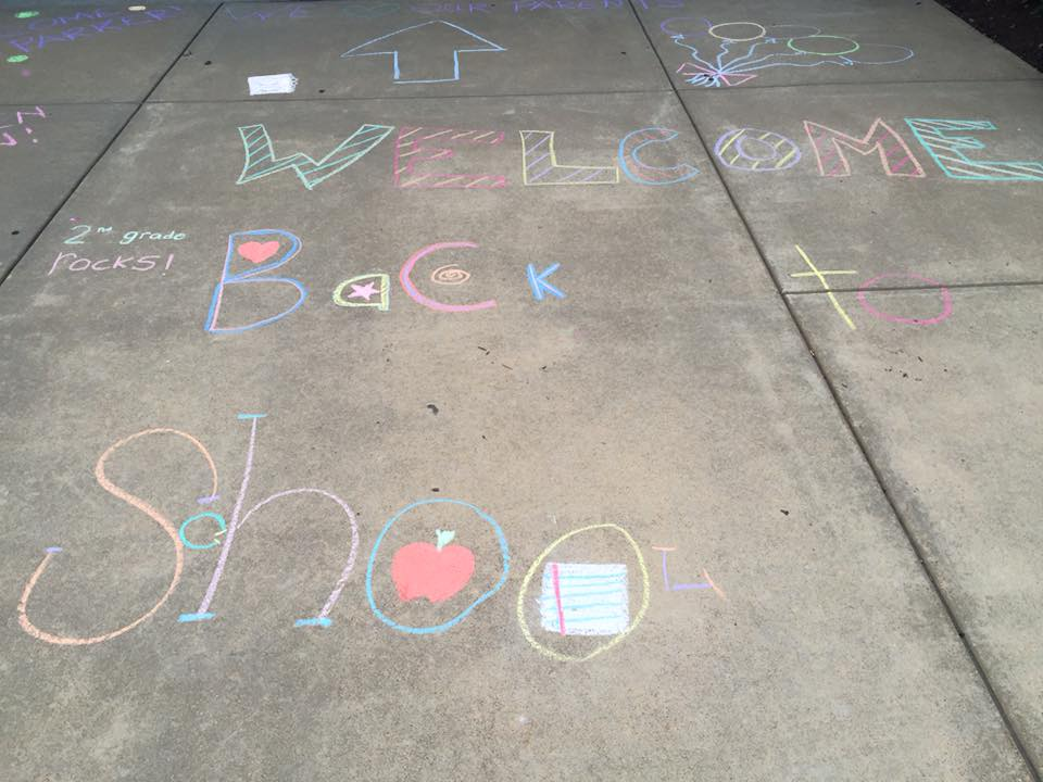 Decorating the sidewalks with chalk for the first day of school
