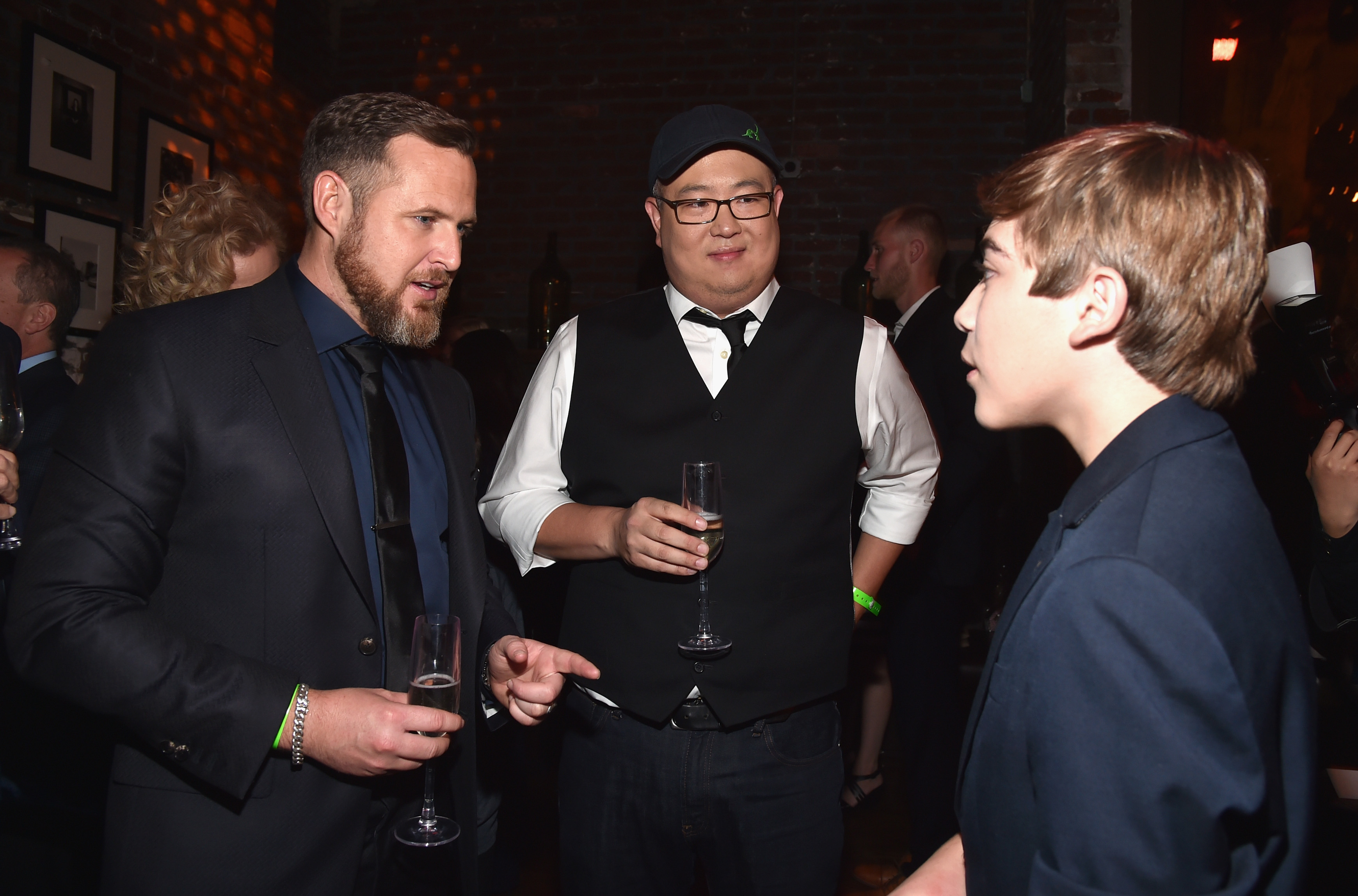 HOLLYWOOD, CA - NOVEMBER 17: (L-R) Actor A.J. Buckley, director Peter Sohn, and actor Raymond Ochoa attend the World Premiere Of Disney-Pixar's THE GOOD DINOSAUR at the El Capitan Theatre on November 17, 2015 in Hollywood, California. (Photo by Alberto E. Rodriguez/Getty Images for Disney) *** Local Caption *** A.J. Buckley; Peter Sohn; Raymond Ochoa